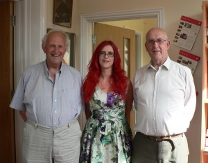 Carolyn, with her father on her right, and Geoff Kirk.